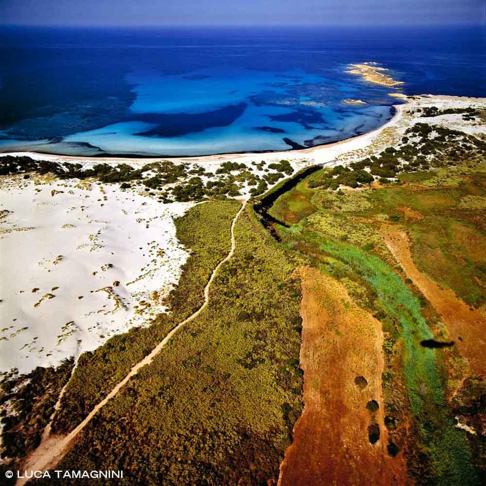 Sardegna, Dune e Spiaggia di Capo Comino dal cielo (foto aerea)