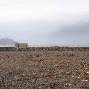 Isole Egadi Isola di Favignana Cala Pozzo sullo sfondo il mare e l'Isola di Marettimo