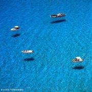 Isola di Lampedusa barche a Cala Tabaccara su un mare limpido