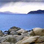 Sardegna, Villasimius, promontorio di Capo Carbonara, scogli di Punta Santo Stefano sullo sfondo il mare e Capo Boi
