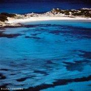 Sardegna, Spiaggia di Punta Molentis ripresa dall'alto con mare turchese