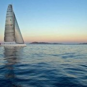 Sardegna, Costa Smeralda barca a vela Wally sullo sfondo l'Isola di Mortorio / Luca Tamagnini Catalogo 2009-019