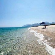 Sardegna, La lunghissima Spiaggia di Planargia con un unico ombrellone
