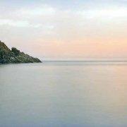 Foto Mare Calabria. Palmi Scoglio Olivella in un mare piatto al tramonto. (Immagini Mare / Album Italia)