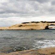 Sardegna, S'Archittu, l'arco naturale in pietra bianca in un giornata nuvolosa / Luca Tamagnini Catalogo 2018-056